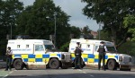 Armed police block a road leading to the