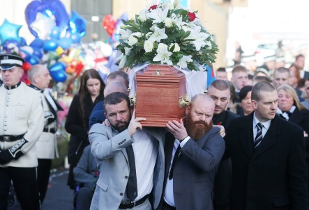 Press Eye - Belfast - Northern Ireland - 4th February 2019 Funeral of murder victim Ian Ogle at Covenant Love Church on the Albertbridge Road in east Belfast. The 45-year-old died after being assaulted by several people at Cluan Place area of east Belfast last week. Ian Olge's coffin leaves his home in Cluan Place for a the funeral service and is carried by his son Ryan. Picture by Jonathan Porter/PressEye