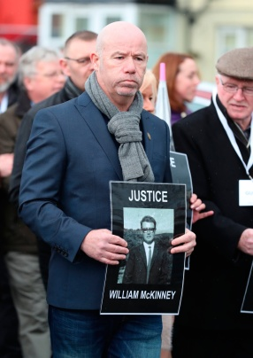 John McKinney holds a picture of his brother, William, as the families of those who died march through the Bogside in Londonderry, in Northern Ireland, ahead of an announcement over the prosecution of 17 former British soldiers and two former members of the Official IRA in connection with the events of Bloody Sunday in the city in January 1972. PRESS ASSOCIATION Photo. Picture date: Thursday March 14, 2019. See PA story ULSTER Sunday. Photo credit should read: Liam McBurney/PA Wire