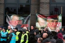 Supporters hold a posters of Edward Heath former British Prime Minister and General Sir Michael David Jackson outside the city hotel Londonderry, Northern Ireland ahead of the announcement as to whether 17 former British soldiers and two former members of the Official IRA will be prosecuted in connection with the events of Bloody Sunday in the city in January 1972. PRESS ASSOCIATION Photo. Picture date: Thursday March 14, 2019. See PA story ULSTER Sunday. Photo credit should read: Niall Carson/PA Wire