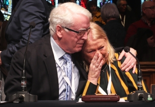 Alternative-Crop John Kelly comforts Alana Burke at the Guildhall in Londonderry, Northern Ireland, after the announcement from the Public Prosecution Service that one former paratrooper, soldier F is to be charged with two murders and four attempted murders during Bloody Sunday in Londonderry in 1972.