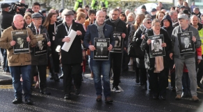 Relatives of those who died march to the Guildhall in Londonderry, Northern Ireland, after the announcement from the Public Prosecution Service that one former paratrooper, soldier F is to be charged with two murders and four attempted murders during Bloody Sunday in Londonderry in 1972.