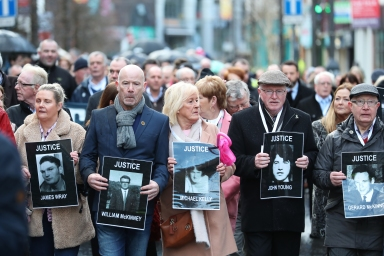 Families of those who died march through the Bogside in Londonderry, in Northern Ireland, ahead of an announcement over the prosecution of 17 former British soldiers and two former members of the Official IRA in connection with the events of Bloody Sunday in the city in January 1972.