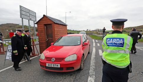 A garda watches from the south as a mock customs post is put up Border Communities Against Brexit protesters on Old Belfast Road in Carrickcarnon on the northern side of the Irish border, between Newry and Dundalk. The day of protest is against a hard border in Ireland. PRESS ASSOCIATION Photo. Picture date: Saturday March 30, 2019. See PA story POLITICS Brexit. Photo credit should read: Niall Carson/PA Wire