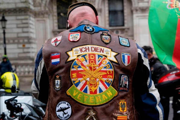 A motorcyclist displays a badge on his jacket dedicated to Veterans, in central London on April 12, 2019, during a protest against the Bloody Sunday prosecution of Soldier F and in support of all Veterans. - A former British soldier faces murder charges of two people after troops opened fire on civil rights demonstrators on Bloody Sunday in Londonderry in 1972. (Photo by Niklas HALLE'N / AFP)NIKLAS HALLE'N/AFP/Getty Images