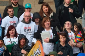 Nichola Corner, the sister of murdered journalist Lyra McKee, sings along to Snow Patrol with other family members and friends at the Guildhall in Derry, Northern Ireland, as they arrive at the end of their three-day peace walk from Belfast. PRESS ASSOCIATION Photo. See PA story ULSTER Walk. Picture date: Monday May 27, 2019. Photo credit should read: Liam McBurney/PA Wire