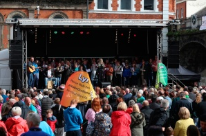 A choir perform in front of hundreds of people at the Guildhall in Derry, Northern Ireland, in the name of Lyra McKee, as friends of the murdered journalist are due to arrive in Londonderry today at the end of their three-day peace walk from Belfast. PRESS ASSOCIATION Photo. See PA story ULSTER Walk. Picture date: Monday May 27, 2019. Photo credit should read: Liam McBurney/PA Wire