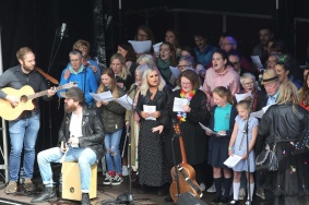 Press Eye - Belfast - Northern Ireland - 27th May 2019 - Photo by Lorcan Doherty / Press Eye. Lyra's Walk The finale of the Peace Walk from Belfast to Derry in memory of Lyra McKee. Lyra's Choir performing in the Guildhall Square.